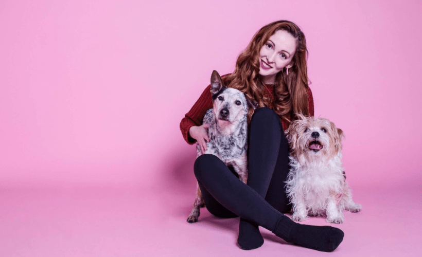 redhead with blue heeler and terrier