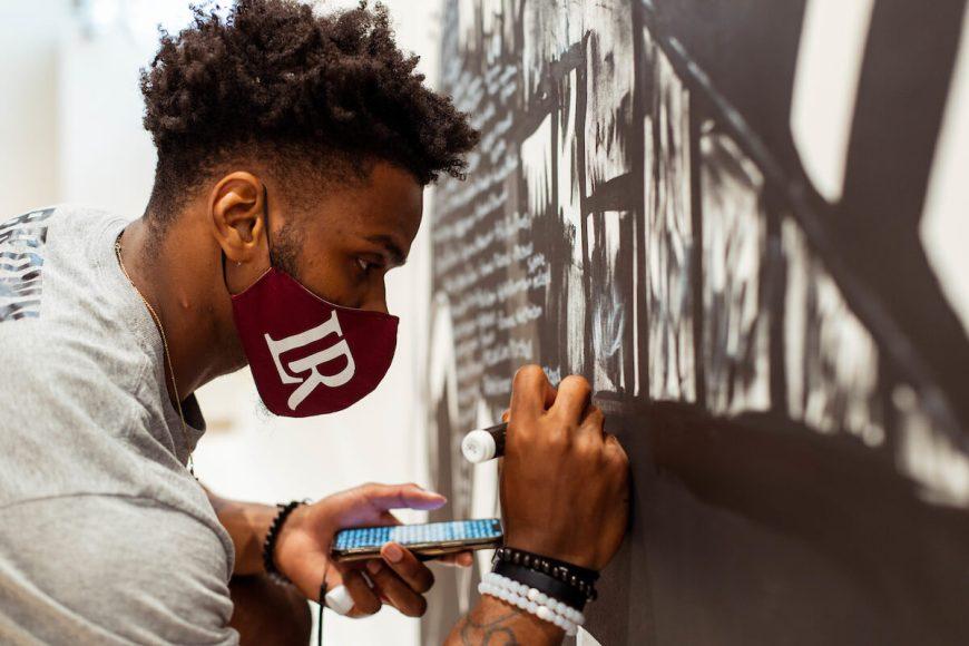 Amari Brown works on BLM mural