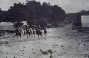 Horseback riders going past Livermore Hotel