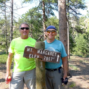 Larry Caswell and his brother-in-law where the old sign has been moved to the new Mt. Margaret location.