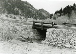 Sand Creek bridge on the Deadman Road under construction by the CCC boys, 1930s