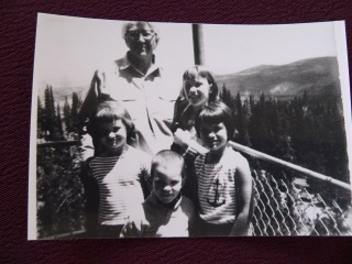 his is Bernice George with her four grandchildren at the tower from Joie and Ray Poulsen.  Starting with Bernice and working clockwise are: Bernice George, Jan (Poulsen) Krentz, Dana (Poulsen) Stewart, Paul Poulsen, and Kim (Poulsen) Farmer.