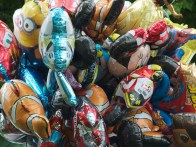 A mass of balloons in the shape of Disney Pixar characters