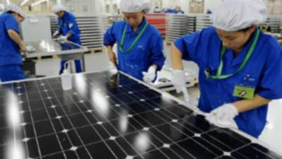 China solar workers at Motech Industries renewable energy
