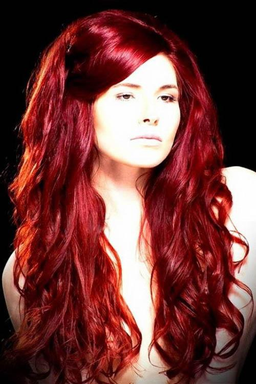 Long ruby red curly hairstyle