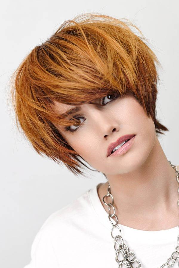 Messy light auburn bob hair cut