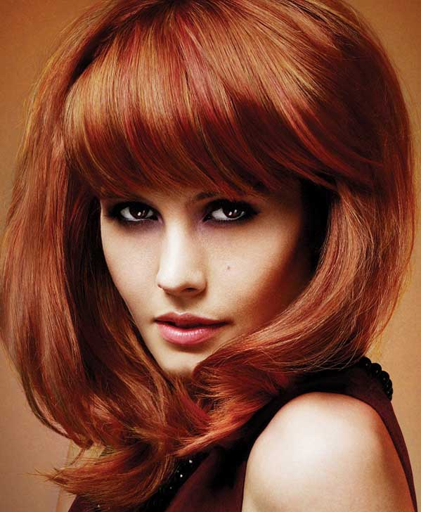 Copper color hairstyle with bangs and dark copper lowlights