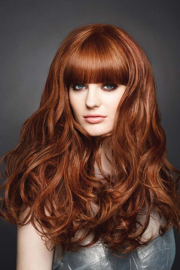 Long rich auburn hairstyle with thick bangs