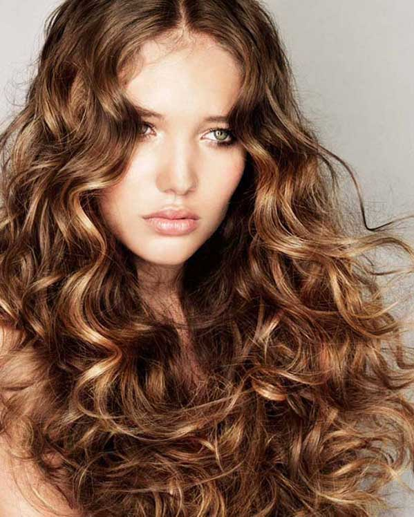 Long brown curly hairstyle with middle parting