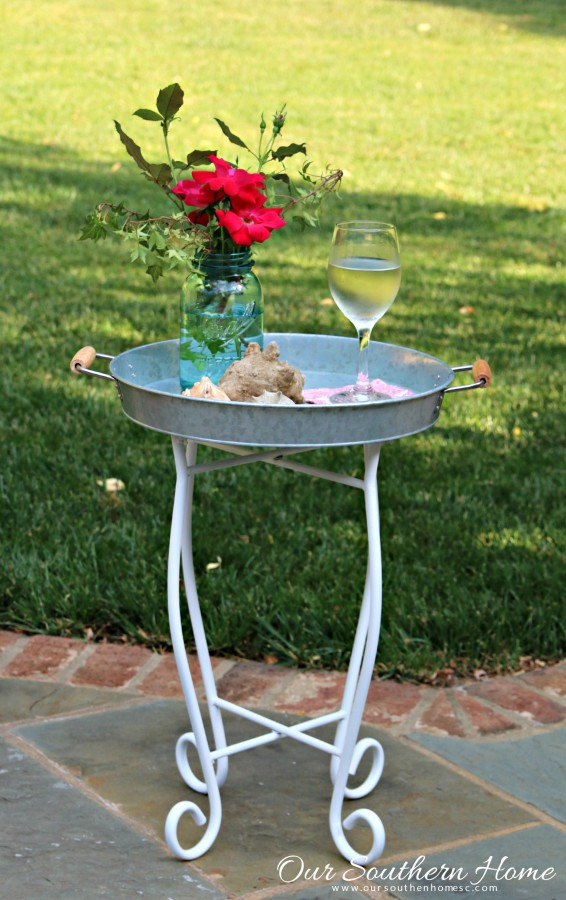 Small outdoor table makeover by our southern home using an old upcycled base and supplies from Walmart #themedfurnituremakeoverday