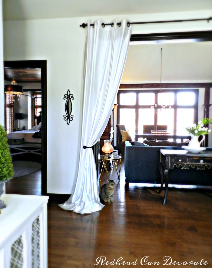 living room panel curtains. Grommet curtain panels hung in the entry way make a Panel Curtains for Living Room Entrance  Redhead Can Decorate