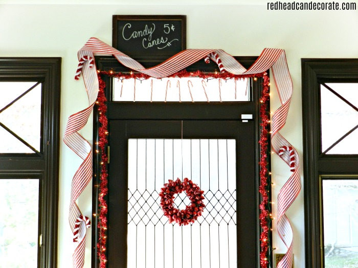 "What a gorgeous idea to decorate a ""candy cane door"" for Christmas. She also used gallery glass to make her window look frosted!"