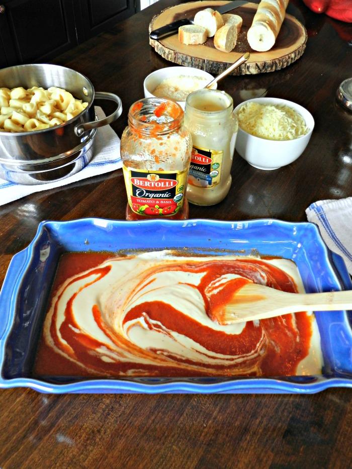 This 30 Minute Cheesy Tortellini Bake combines Bertolli® Organic Traditional Tomato & Basil Sauce and Bertolli® Organic Creamy Alfredo Sauce to make a savory yummy Rosa Sauce.