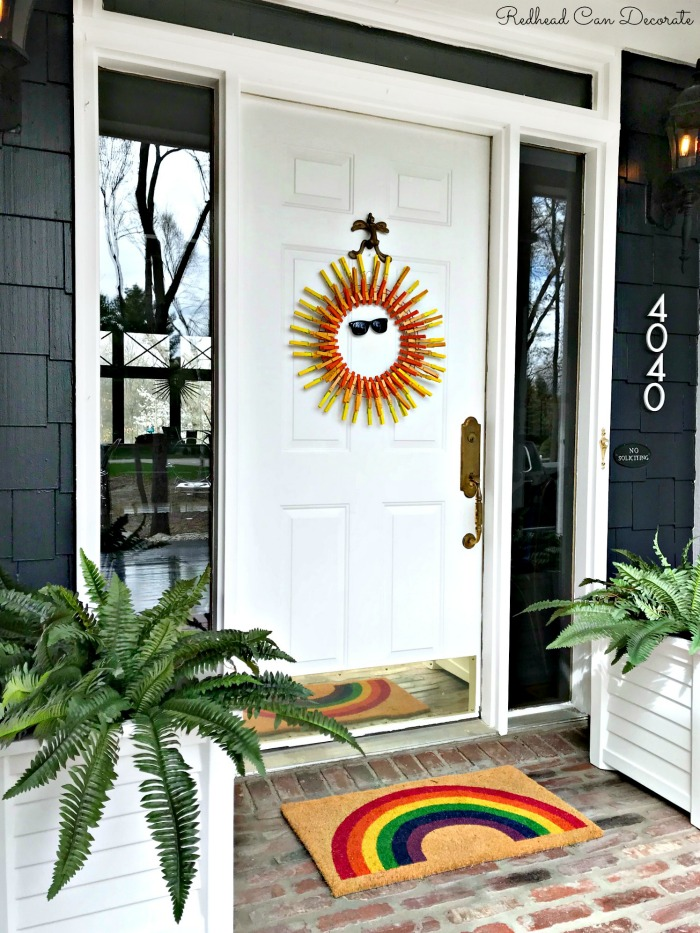 ThIs do it yourself crafty bright and cheery sun clothespin wreath can be made in minutes with household clothespins and spray paint!