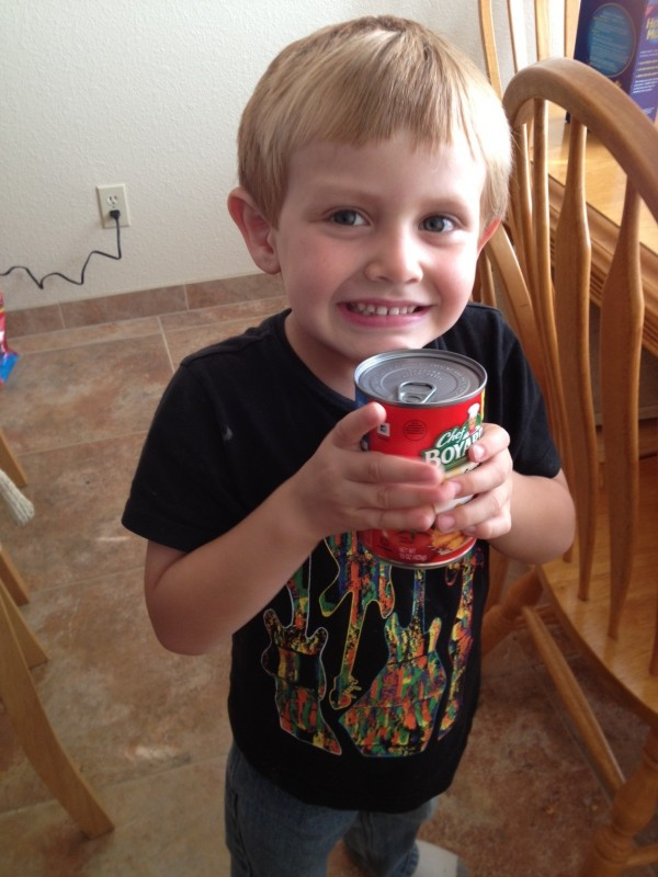 boy holding a can