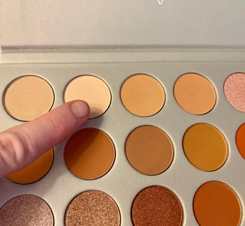 a close-up of an eyeshadow palette
