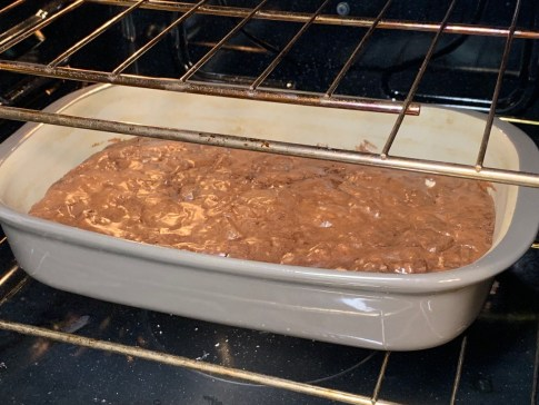 Cooked brownies in pan in oven
