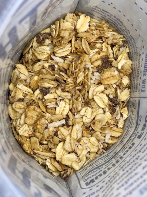 bag of granola with coconut, dark chocolate and quinoa