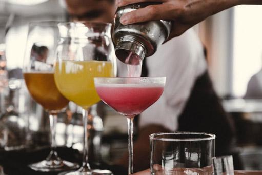 bartender pouring drinks
