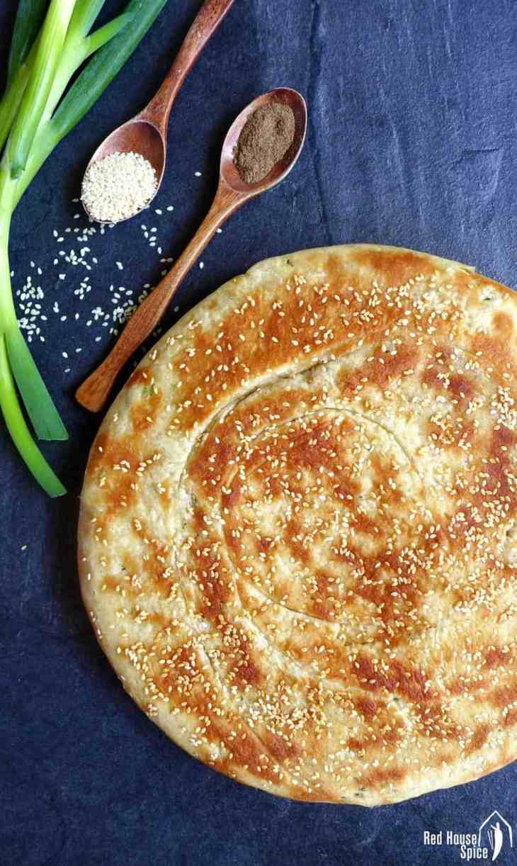 Beautifully seasoned, crispy on the surface and fluffy inside, this leavened spring onion flatbread only take 10 mins to cook in a pan.