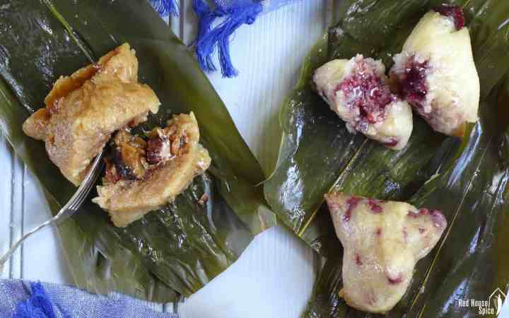 Chinese sticky rice dumplings over bamboo leaves.
