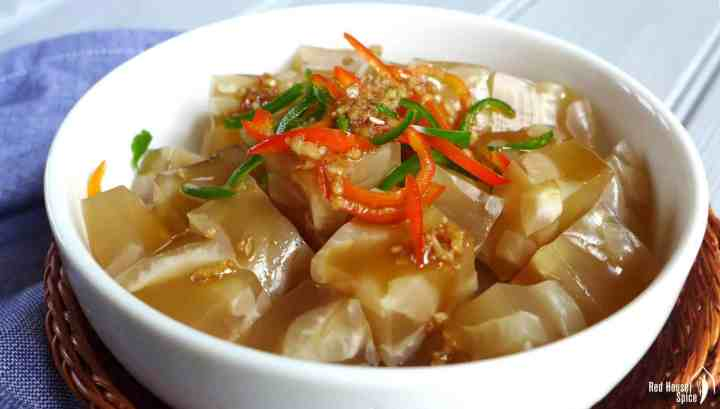 Chinese pork rind jelly garnished with fresh chillies