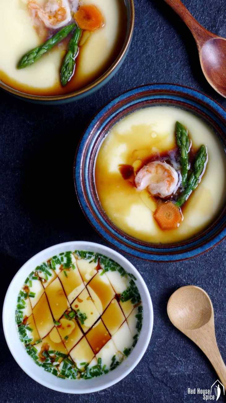 To make basic steamed eggs more visually appetizing, you can garnish it with prawns and vegetables like asparagus, carrot, etc.