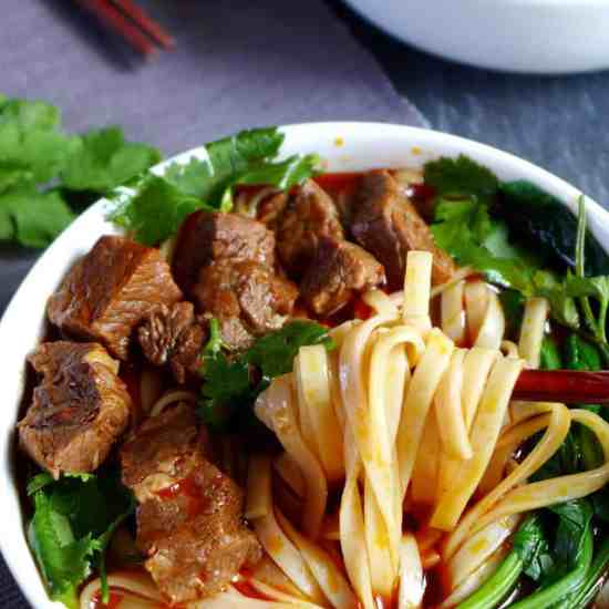 A bowl of noodles in well spiced broth topped with tender beef cubes, spicy beef noodle soup is hot, fragrant and very comforting indeed.
