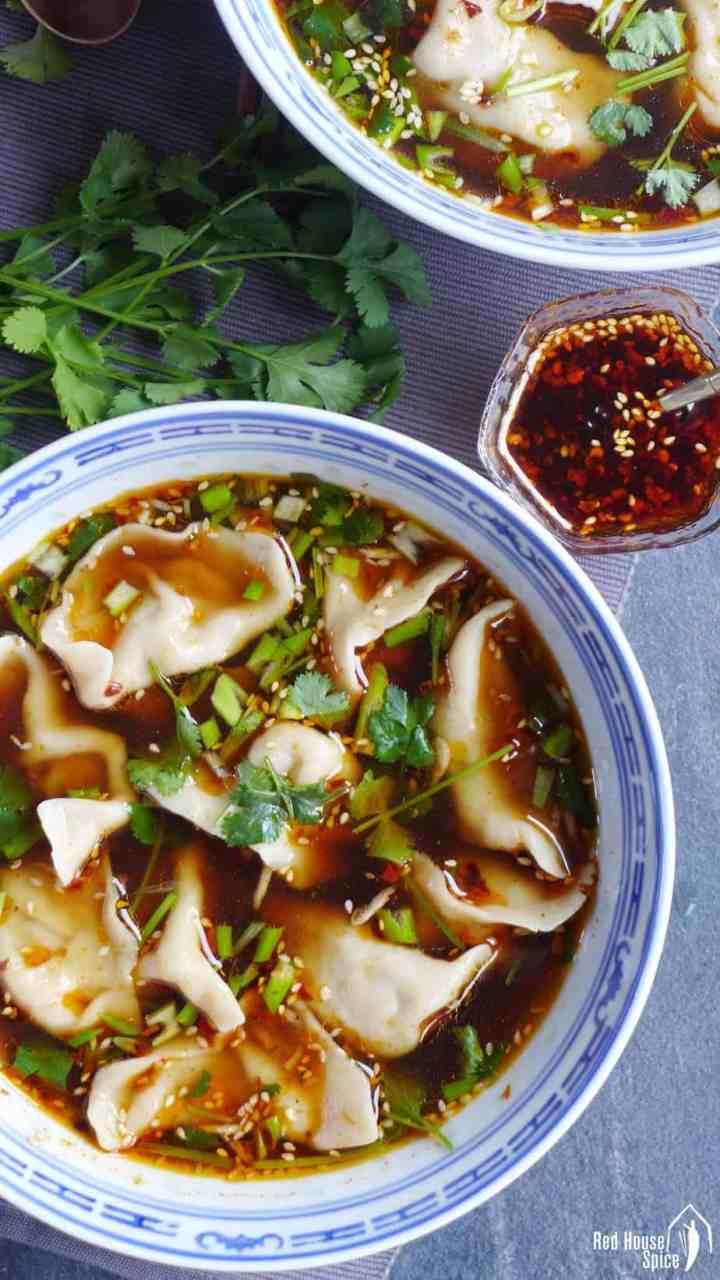 A bowl of beef dumpling soup