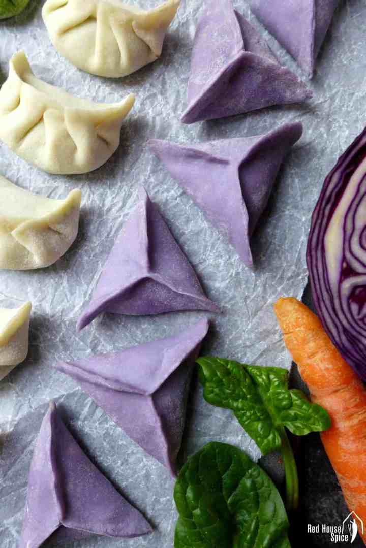 Chinese dumplings in purple colour and triangle shape.