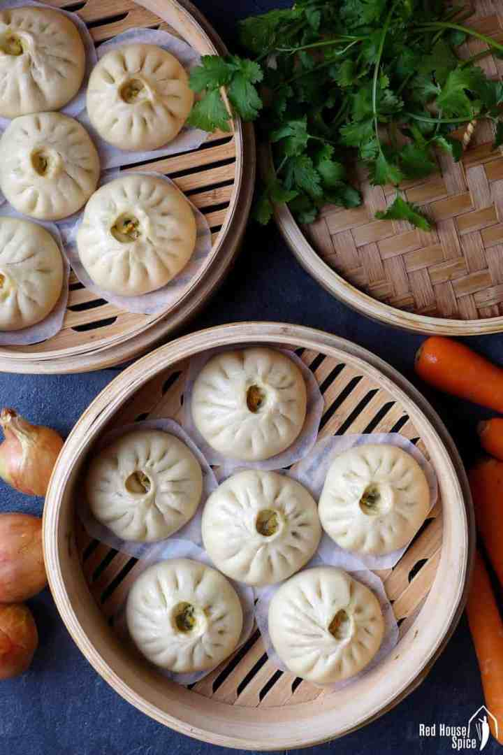 Stuffed bao buns in steamers