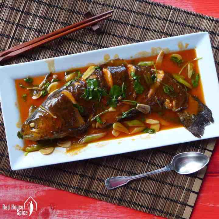 A whole fish cooked in sweet and sour sauce
