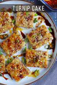 sliced turnip cake pieces with soy sauce