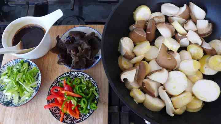 Chopped mushrooms and other ingredients for stir-frying