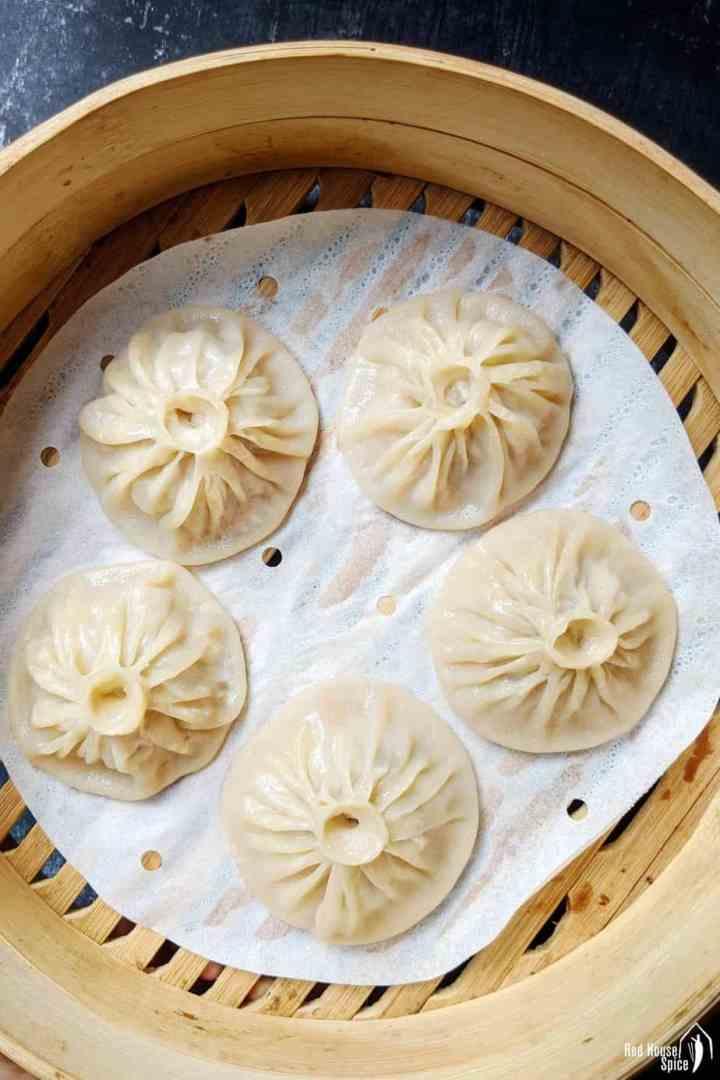 Soup dumplings in a steamer basket