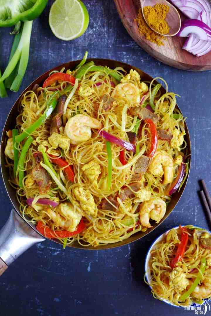 A wok packed with Stir-fried Singapore Mei Fun