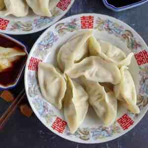 a plate of boiled pork dumplings