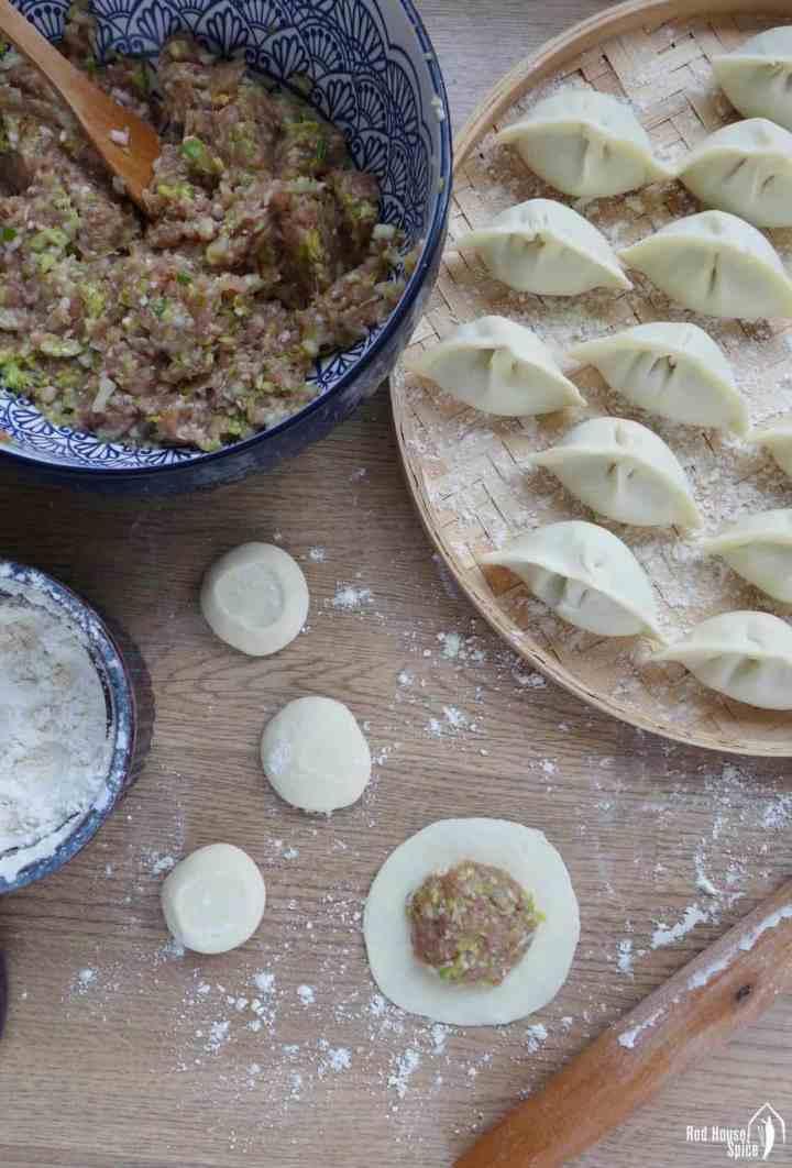 dumpling filling, a dumpling wrapper and assembled dumplings