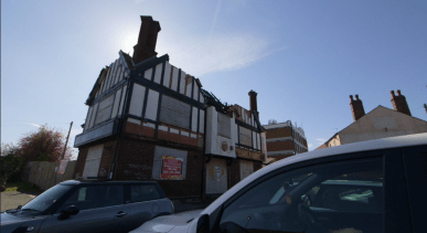 View of The Bulls Head pub 2016 with caved in roof and windows boarded up.