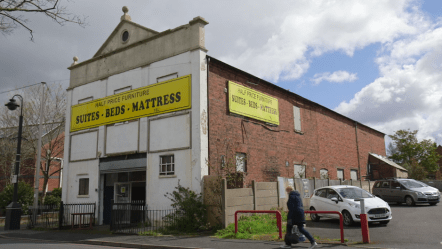 The former Bloxwich Wesleyan Methodist Church 2016, now shows large sign as furniture store
