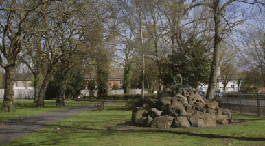 A video still of The anvil stones heaped in a mound in Bloxwich park in celebration of the local metal work industry