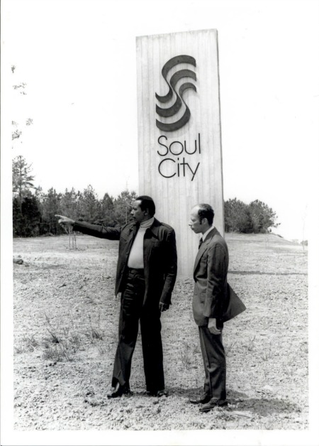 Floyd B. McKissick (L) and Kimp Talley stand in front of huge 20 ft. steel and concrete sculpture which graces the entrance to Soul City at the intersection of U.S. Highway 1 and Soul City Blvd. (NAID 12584354)