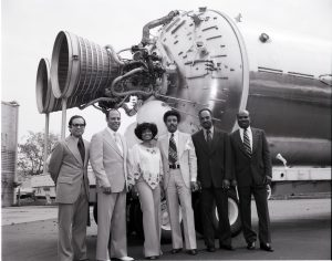 black and white photograph of a group of people including Nichelle Nichols standing in front of a spacecraft