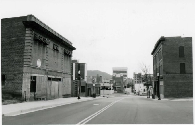 view of a street with buildings on either side of the road, Henry Street