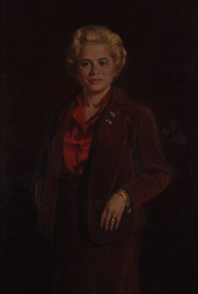 oil painting of former Secretary Harris in full length, wearing a brown/red pants suit