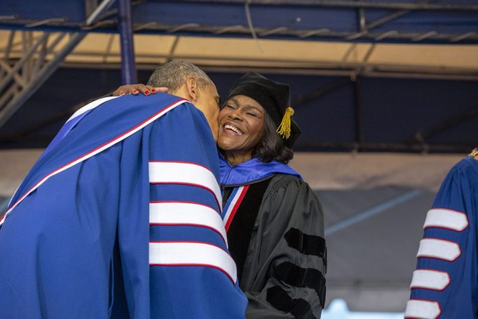Cicely Tyson in graduation gown getting a kiss on the cheeck from Barack Obama