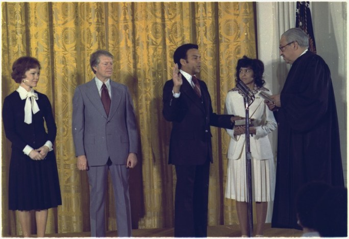 Young w/hand on Bible standing in front of Thurgood Marshall, with President Carter in background