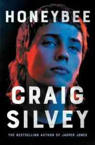 Book cover depticing a young person looking serious and brooding with a mullet on a black background.