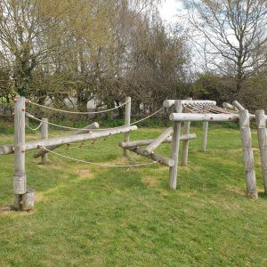 wooden climbing equipment in playground in bucks