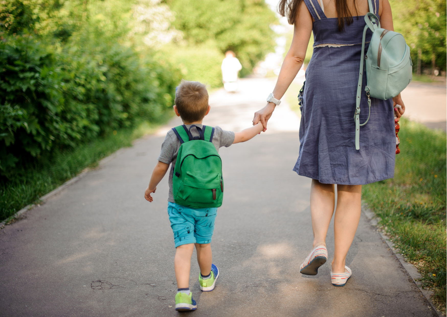 parent and child holding hands walking to preschool